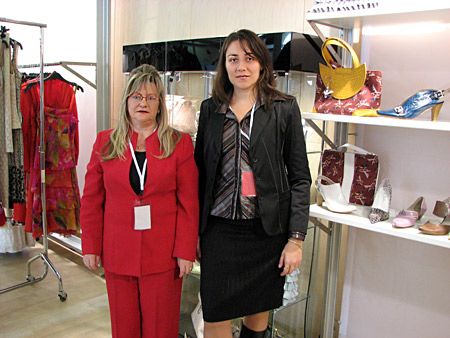 The designer Imelda Sánchez together with Silvia Kabaivanova, manager of  Fashion.bg in front of the stand of by Imelda during the Castilla y Leon Fashion week